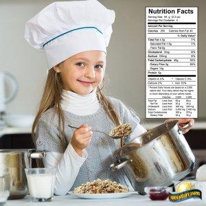 Sweet girl preparing oatmeal for breakfast in kitchen